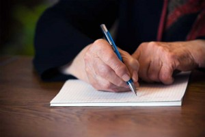 man writing an intervention letter