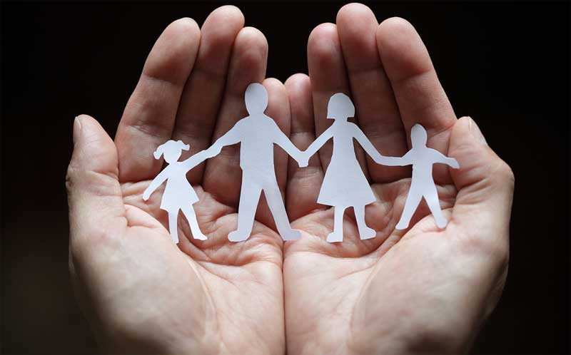hands holding cut out family