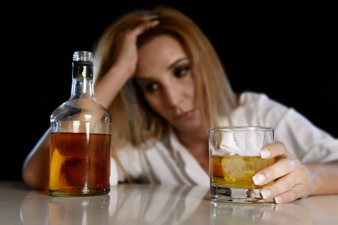 Young woman binge drinking