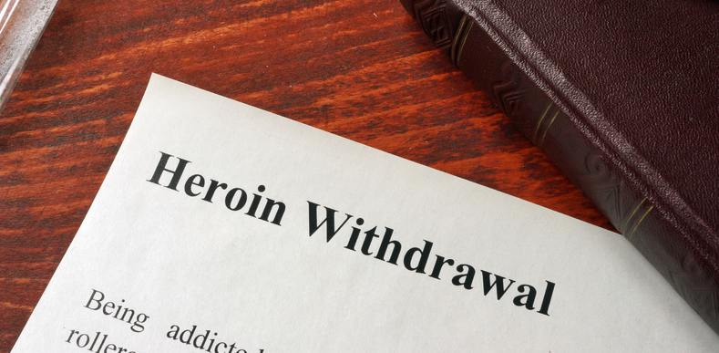 Paper on a desk that says Heroin Withdrawal