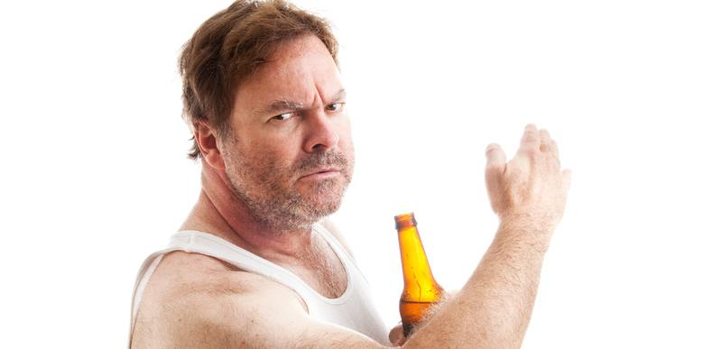 Angry man with a beer about to slap.