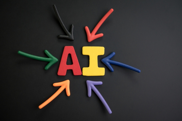 The letters AI in red and yellow with colored arrows pointing to them.