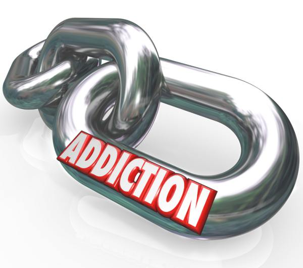 Steel chain with the words Addiction on it.