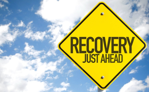 Road sign saying Recovery Just Ahead