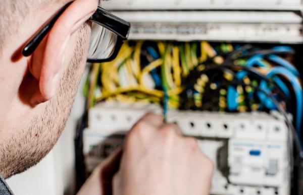 A man fixing a computer