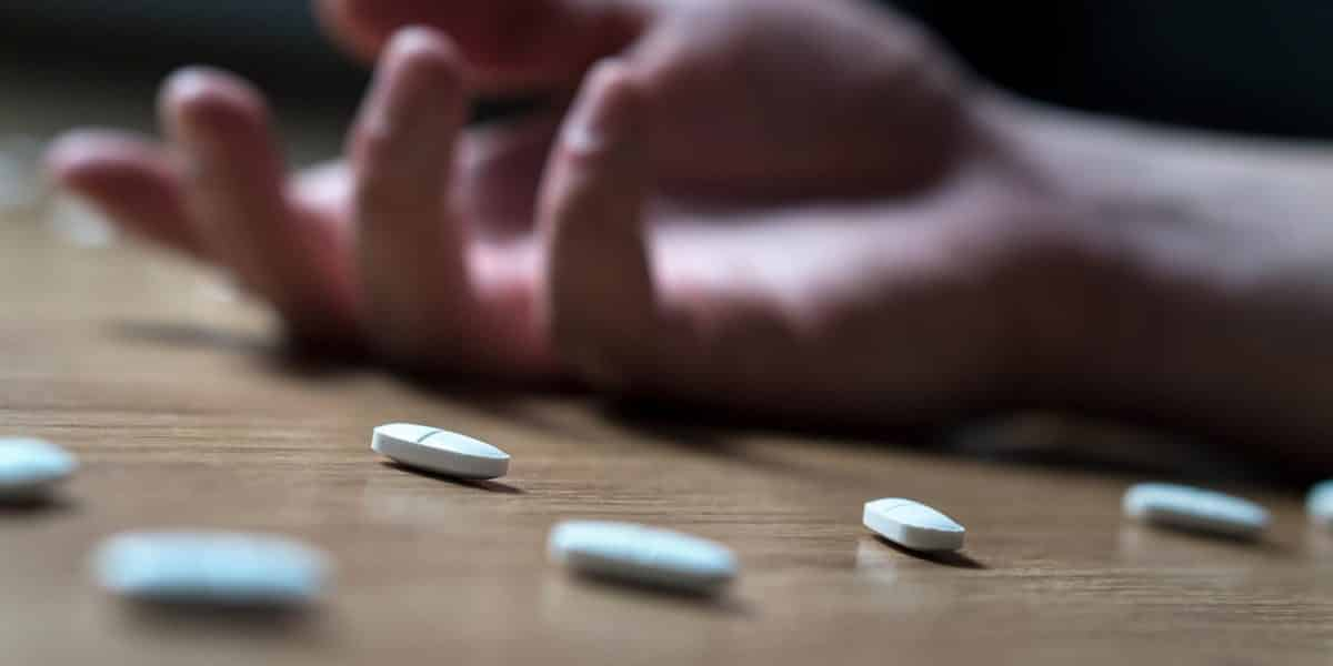 hand of person lying on the floor after overdosing on Klonopin