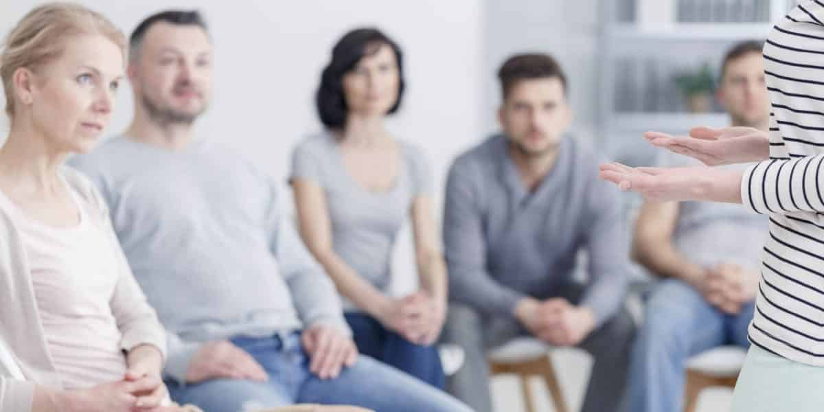 A group of people struggling with stimulant addiction at group therapy as part of stimulant abuse treatment