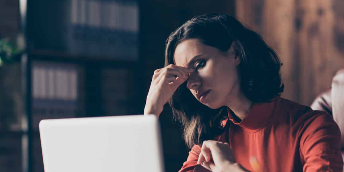 Woman struggling with a valium addiction experiencing side effects while doing work