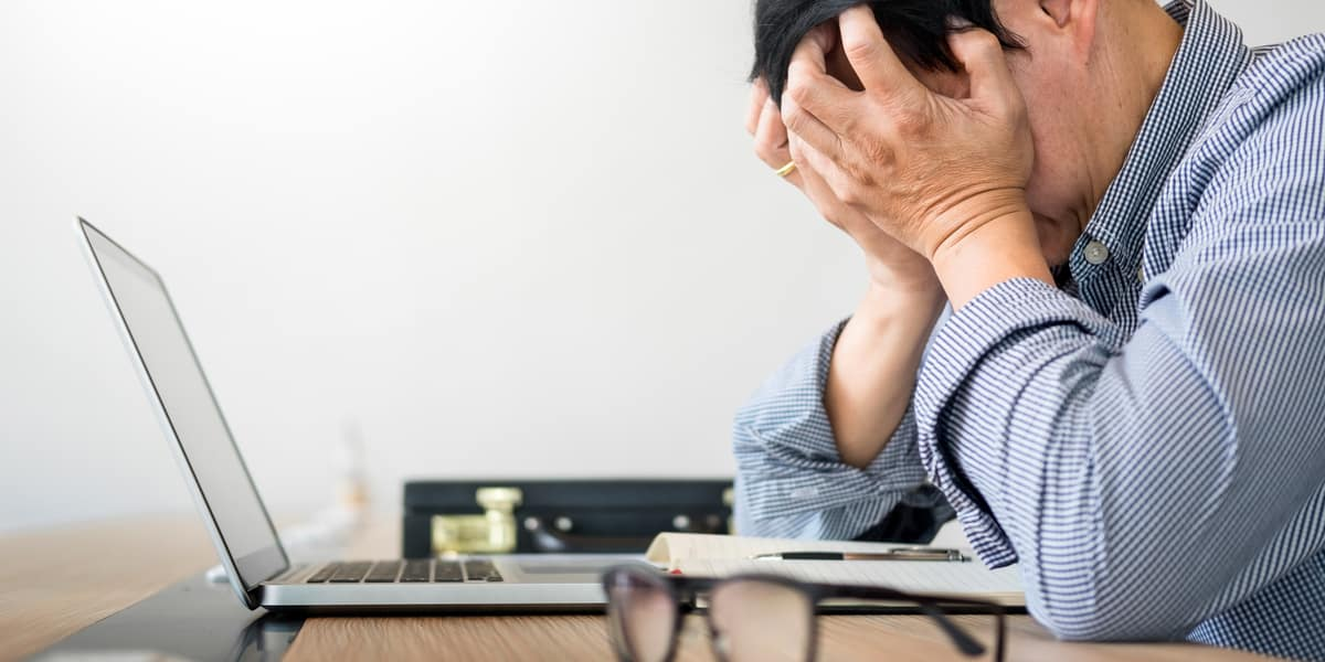 man appearing stressed at work